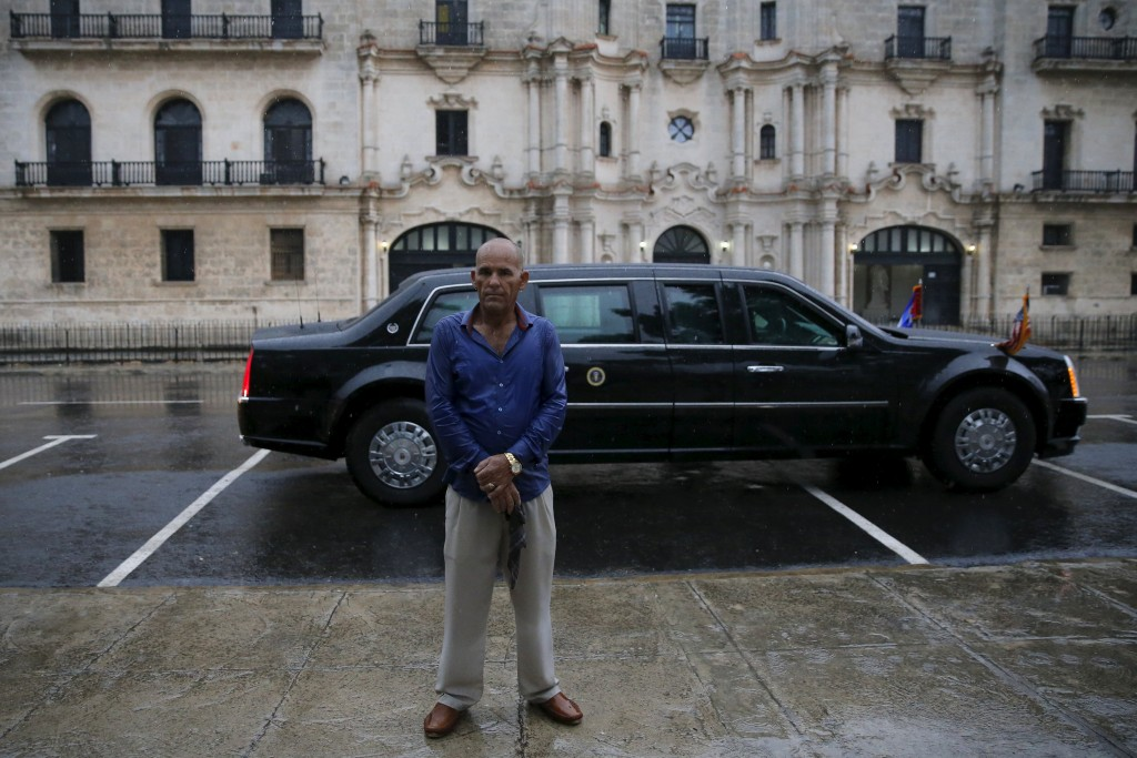 A member of security personnel guards the limousine of U.S. President Barack Obama as he tours Old Havana with his family at the start of a three-day visit to Cuba, in Havana March 20, 2016. REUTERS/Carlos Barria