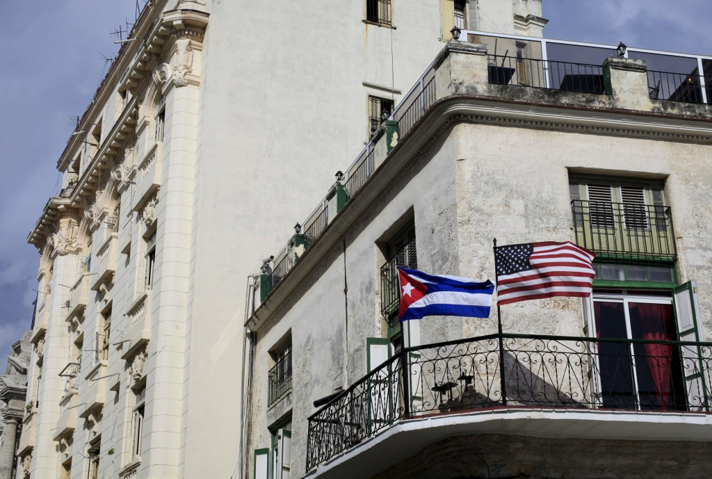 Cuban and U.S. flags are seen on the balcony of a restaurant in Havana, Cuba March 19, 2016. REUTERS/Enrique De La Osa