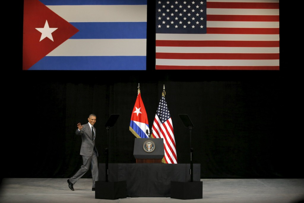 U.S. President Barack Obama waves as he arrives to deliver a speech at the Gran Teatro in Havana, Cuba March 22, 2016. REUTERS/Carlos Barria