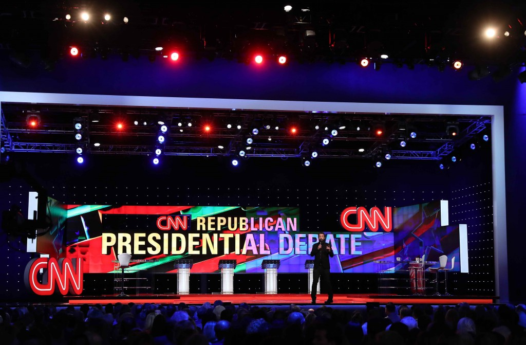 A CNN employee talks to the audience before the start of at the Republican U.S. presidential candidates debate sponsored by CNN at the University of Miami in Miami, Florida March 10, 2016.