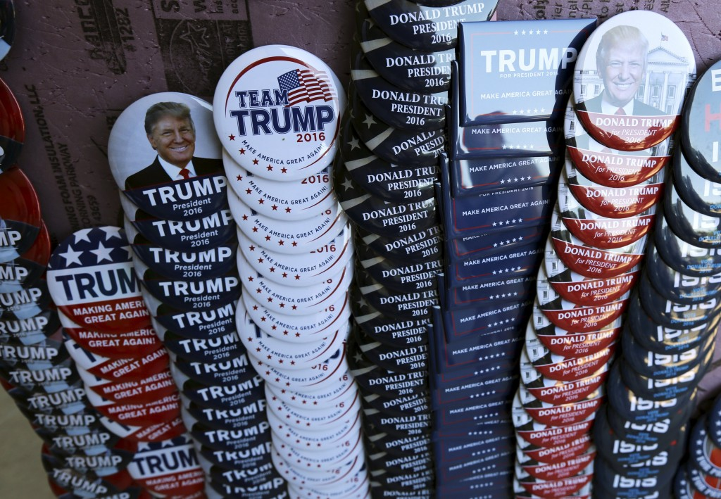 Campaign buttons for Republican presidential candidate Donald Trump are shown outside a campaign event in Tucson, Arizona March 19, 2016. REUTERS/Sam Mircovich