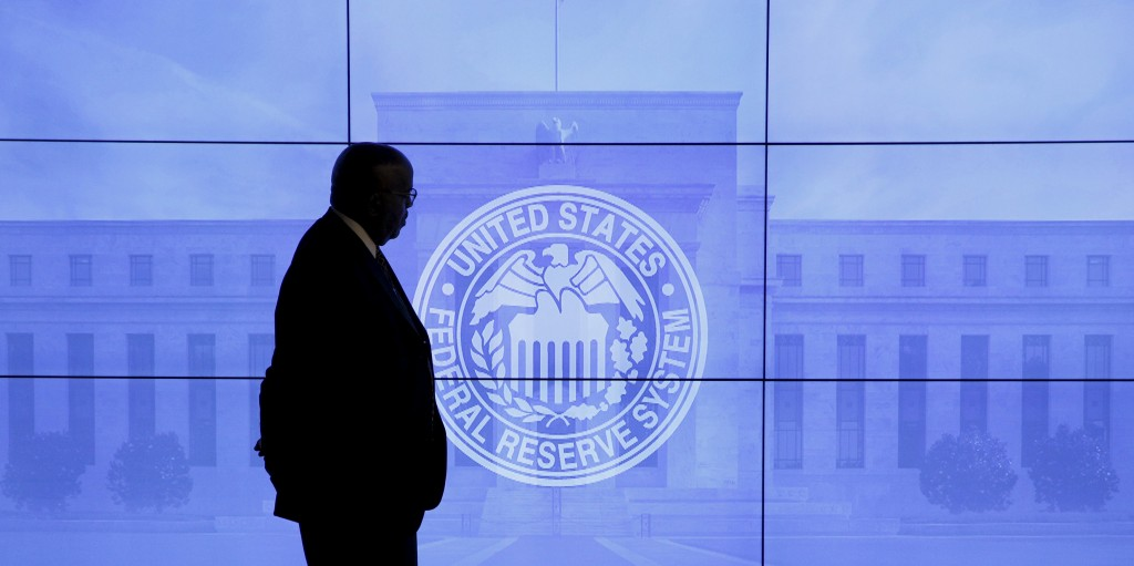 A security guard walks in front of an image of the Federal Reserve before the arrival of U.S. Federal Reserve Chair Janet Yellen to give a news conference following the two-day Federal Open Market Committee (FOMC) policy meeting in Washington. (Kevin Lamarque/Reuters)