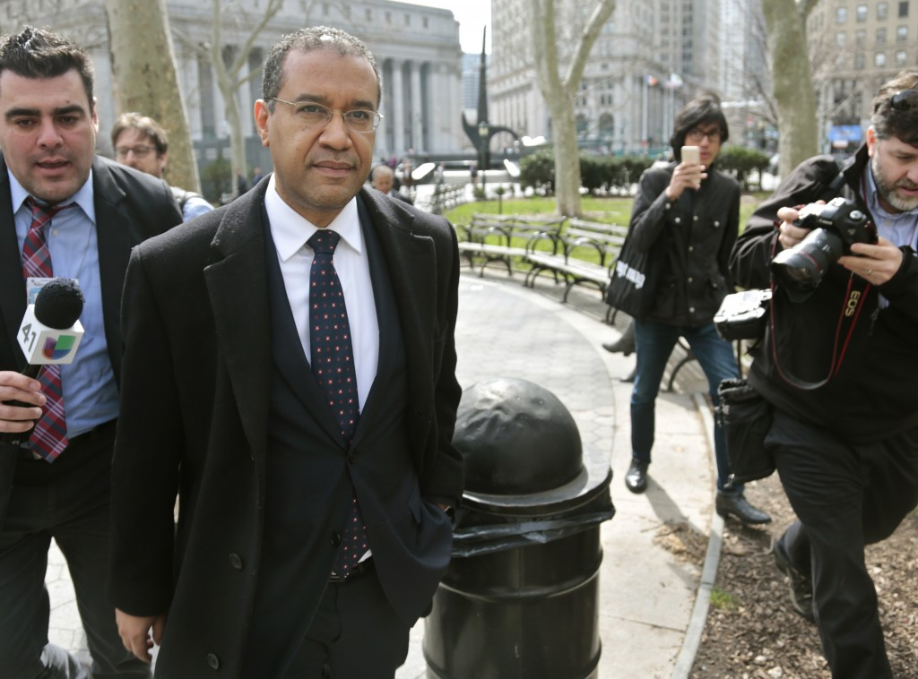 Francis Lorenzo leaves the courthouse in New York after pleading guilty to bribery charges on Wednesday. (AP Photo/Bebeto Matthews)