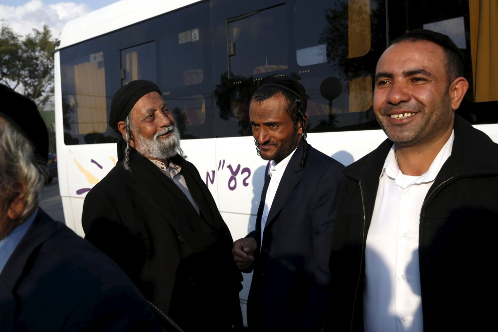 Moshe Dahari (2nd R), one of 19 Jews from Yemen, who were brought to Israel by the quasi-governmental Jewish Agency for Israel, in what immigration officials described as the last covert operation to move members of a dwindling Jewish community dating back two millennia, can be seen at an absorption center in Beersheba, Israel March 21, 2016. REUTERS/Baz Ratner