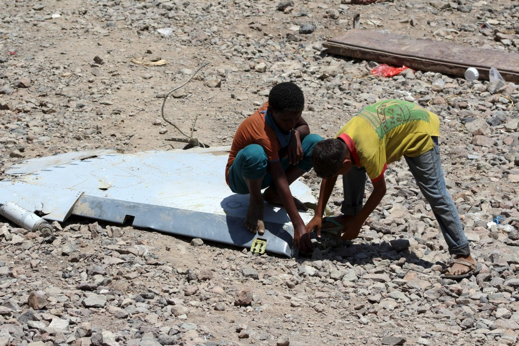 Boys check a part of a United Arab Emirates Mirage plane that crashed in Yemen's southern port city of Aden March 14, 2016. REUTERS/Fawaz Salman