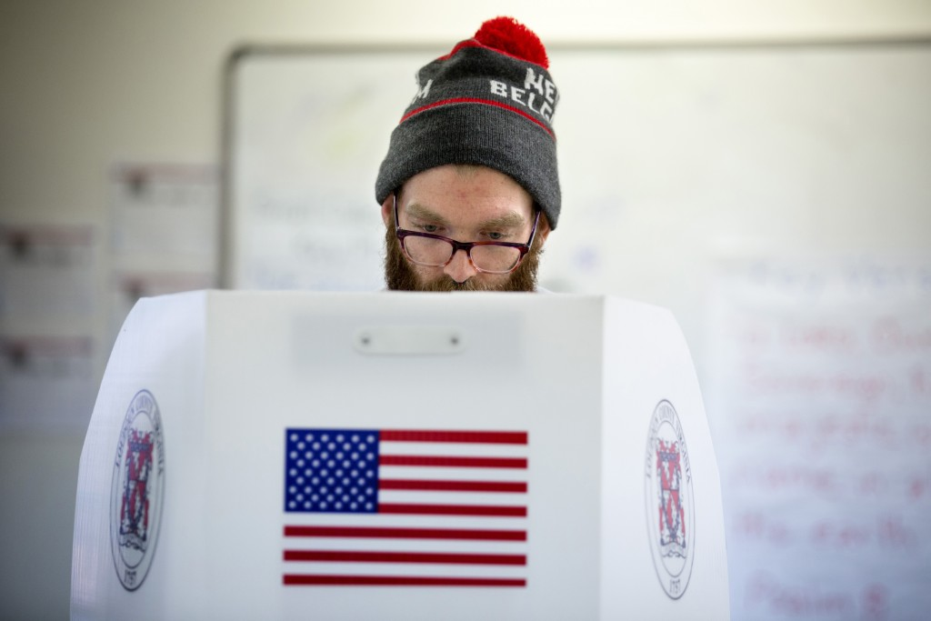 Kyle Stewart, 25, votes during Virginia's primary election for President, March 1, 2016, at the Holy Trinity Lutheran Church in Leesburg, Virginia. (Evelyn Hockstein For The Washington Post)