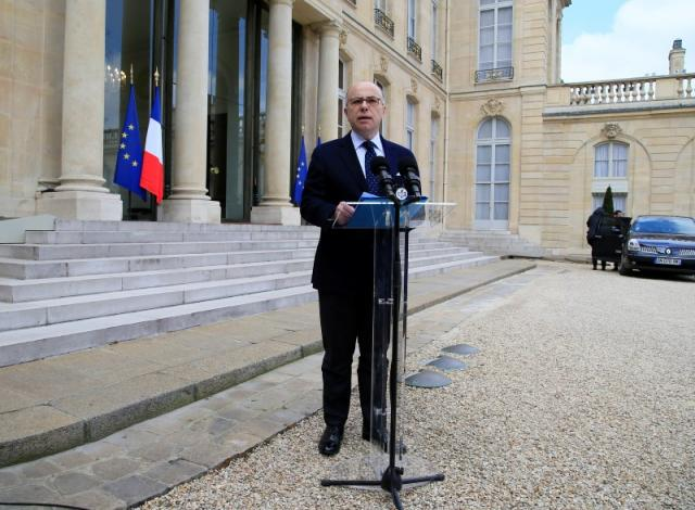 French Interior Minister Bernard Cazeneuve talks to journalists after a meeting about blasts in Brussels at the Elysee Palace in Paris, France, March 22, 2016. REUTERS/Gonzalo Fuentes