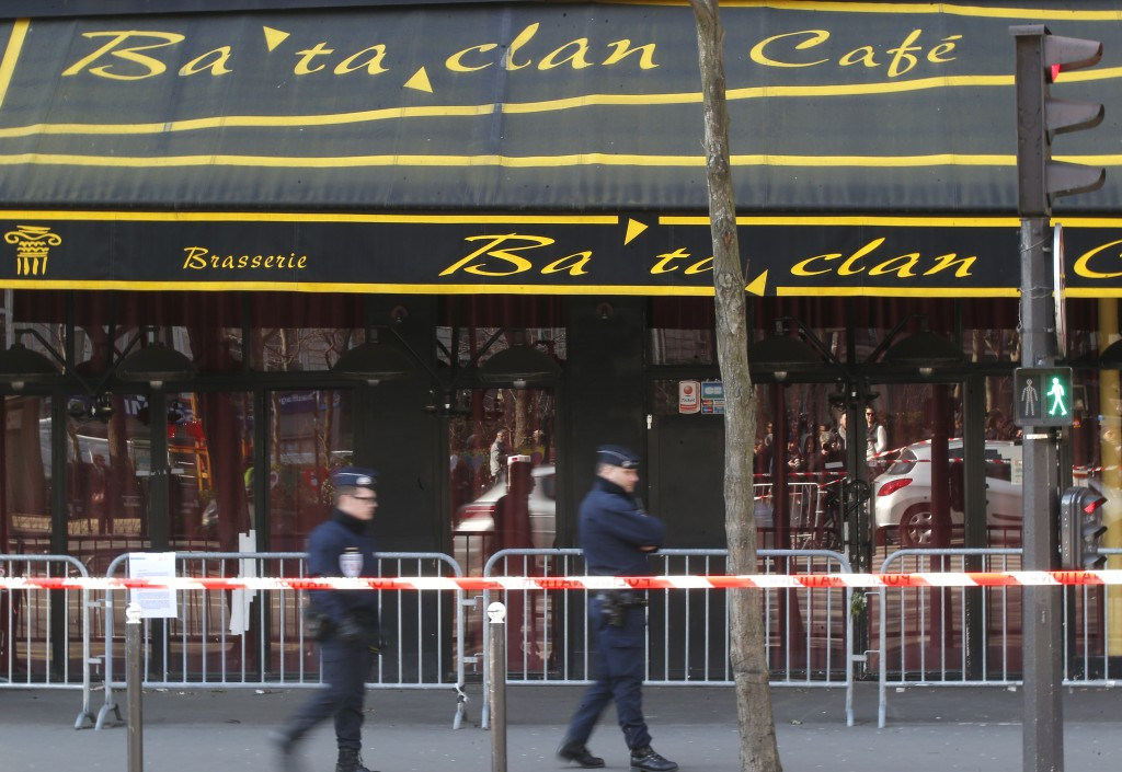 Police officers patrol near the Bataclan concert hall in Paris on Thursday, March 17, 2016, as French lawmakers leading an investigation into the Nov. 13 terror attacks and some of the first responders at the Bataclan concert hall that night returned Thursday to re-enact the horror that left a total of 130 people dead across Paris. (AP Photo/Michel Euler)