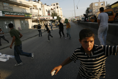 Arabs throw rocks in a riot. Photo by Miriam Alster/FLASH90