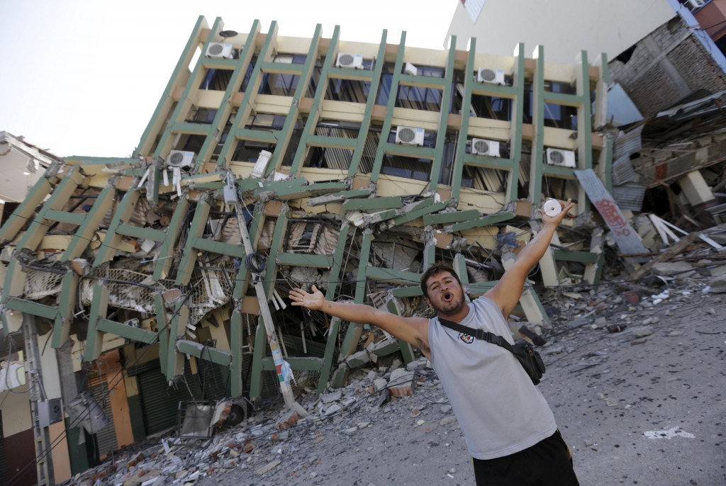 A resident gestures next to a collapsed building after an earthquake struck off the Pacific coast, in Portoviejo,Ecuador, Monday. (Reuters/Henry Romero)