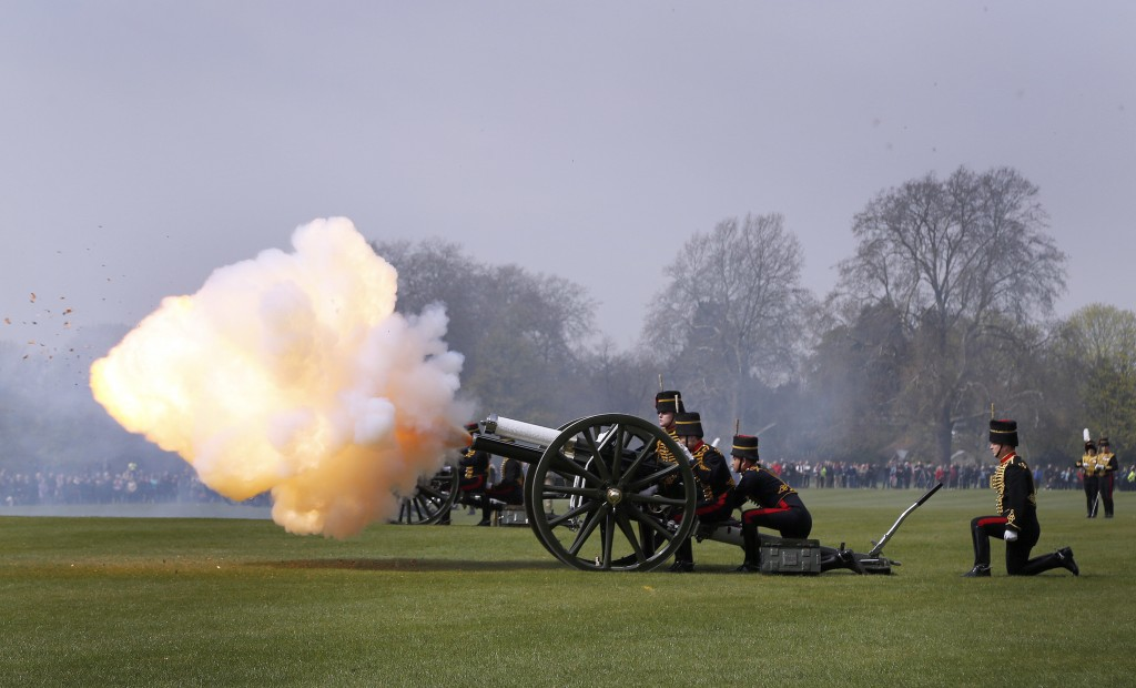 The King's Troop Royal Horse Artillery fire a 41-gun Royal Salute in Hyde Park, London, on Thursday, to mark the 90th birthday of Queen Elizabeth II. (AP Photo/Frank Augstein)