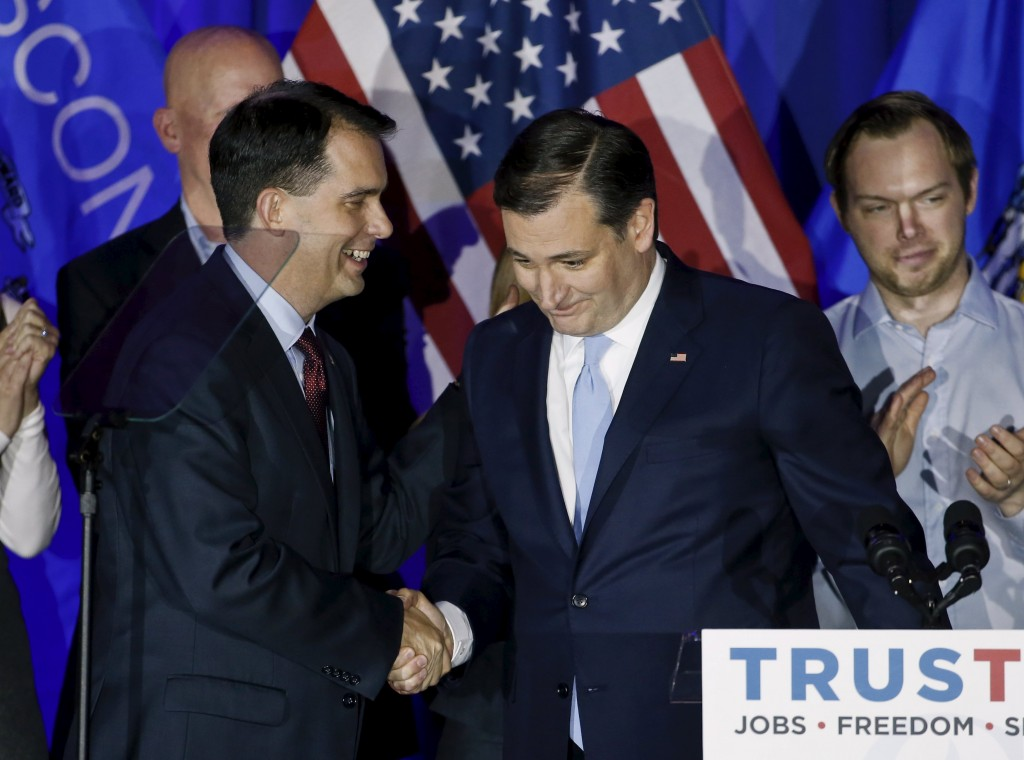U.S. Republican presidential candidate Ted Cruz, (R) is congratulated by Wisconsin Governor Scott Walker (L) during Wisconsin primary night rally at the American Serb Banquet Hall in Milwaukee, Wisconsin. (Kamil Krzaczynski/Reuters)