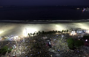 People watch the impeachment session on a big screen in Rio de Janeiro on Sunday evening. (Reuters/Ricardo Moraes)