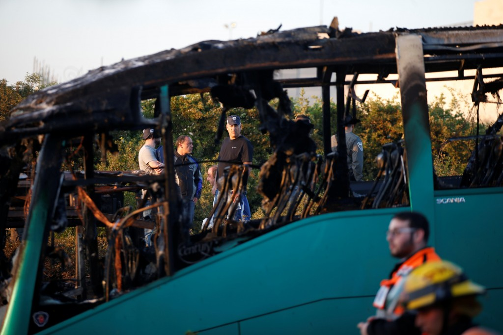 Emergency workers at the scene of the bus blast in Yerushalayim. (Ronen Zvulun/Reuters)