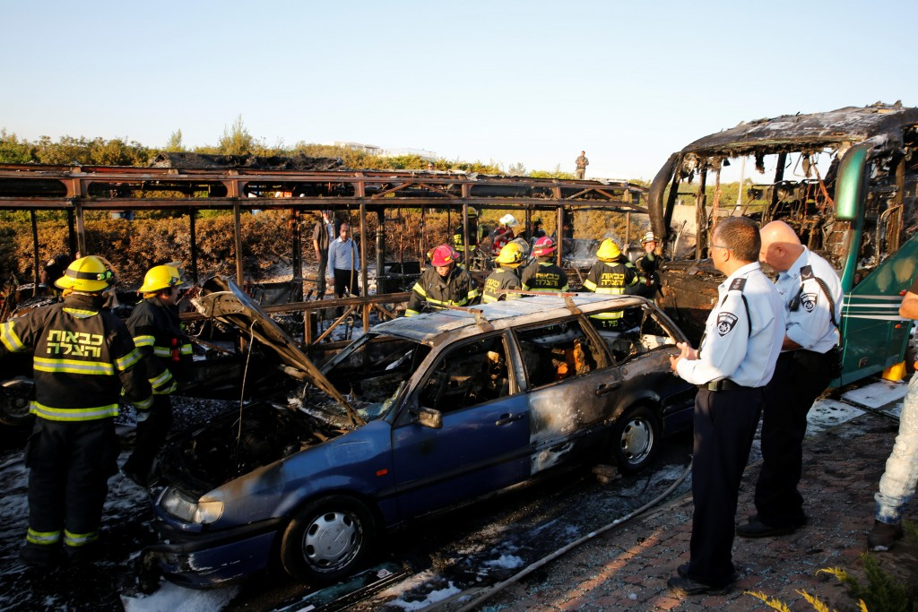 Emergency workers search the scene after a blast on a bus in Yerushalayim. (Ronen Zvulun/Reuters)