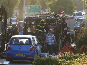 Emergency workers search the scene after a blast on a bus in Yerushalayim. (Ammar Awad/Reuters)