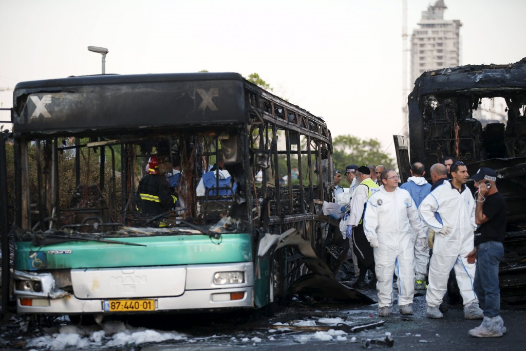 The aftermath of the bus bombing on Derech Chevron (Reuters/Ronen Zvulun)