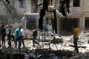 People inspect the damage at a site hit by airstrikes in the rebel-held neighborhood of Bustan al-Qasr, in Aleppo, Syria. (Reuters/Abdalrhman Ismail)