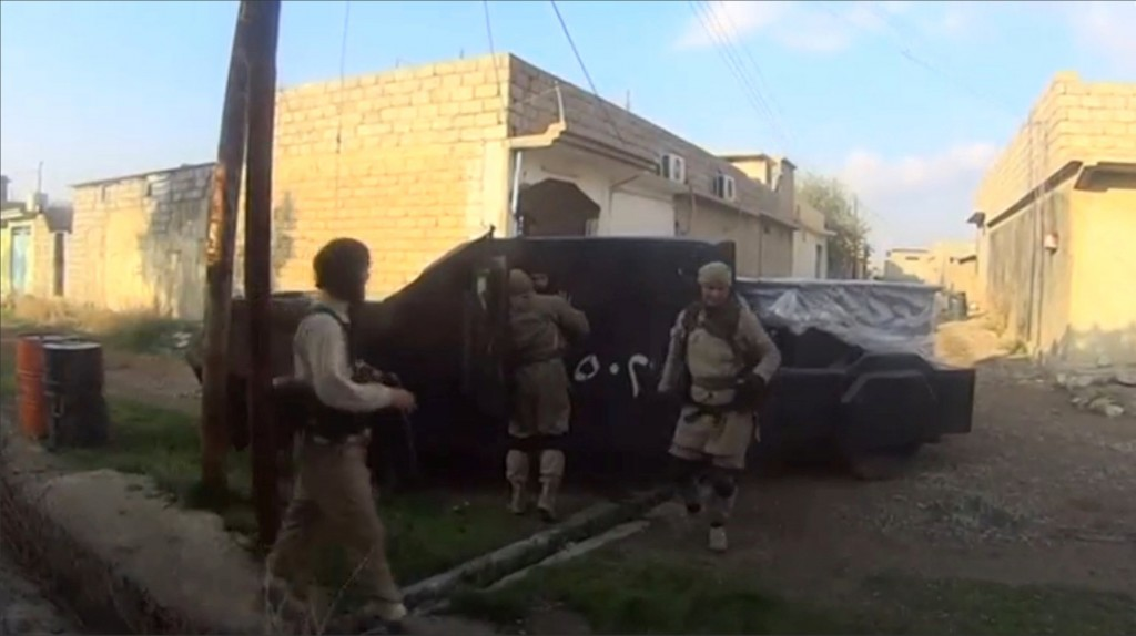 A man in an armoured vehicle, said to be a suicide bomber about to go out on a mission, talks to other Islamic State fighters in Iraq, in this still image taken from an amateur video supplied by Kurdish Peshmerga and received by Reuters on April 29, 2016. Amateur video/via REUTERS TV ATTENTION EDITORS - THIS IMAGE WAS PROVIDED BY A THIRD PARTY. REUTERS IS UNABLE TO INDEPENDENTLY VERIFY THE AUTHENTICITY, CONTENT, LOCATION OR DATE OF THIS IMAGE. EDITORIAL USE ONLY. NO RESALES. NO ARCHIVE.