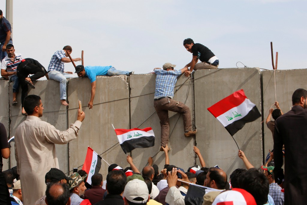 Followers of Iraq's Shi'ite cleric Moqtada al-Sadr storm Baghdad's Green Zone after lawmakers failed to convene for a vote on overhauling the government, in Iraq (Khalid al Mousily/Reuters)