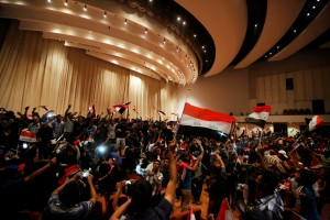 Followers of Iraq's Shi'ite cleric Moqtada al-Sadr are seen in the parliament building as they storm Baghdad's Green Zone after lawmakers failed to convene for a vote on overhauling the government, in Iraq. (Ahmed Saad/Reuters)