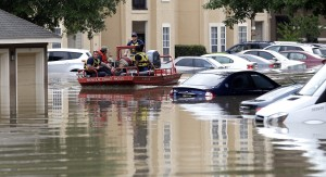 Residents are evacuated from their flooded apartment complex on Tuesday. (AP Photo/David J. Phillip)