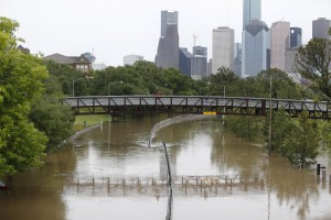 Memorial Drive in Houston is flooded by the overflowing Buffalo Bayou, in Houston on Monday. (Karen Warren/Houston Chronicle via AP)