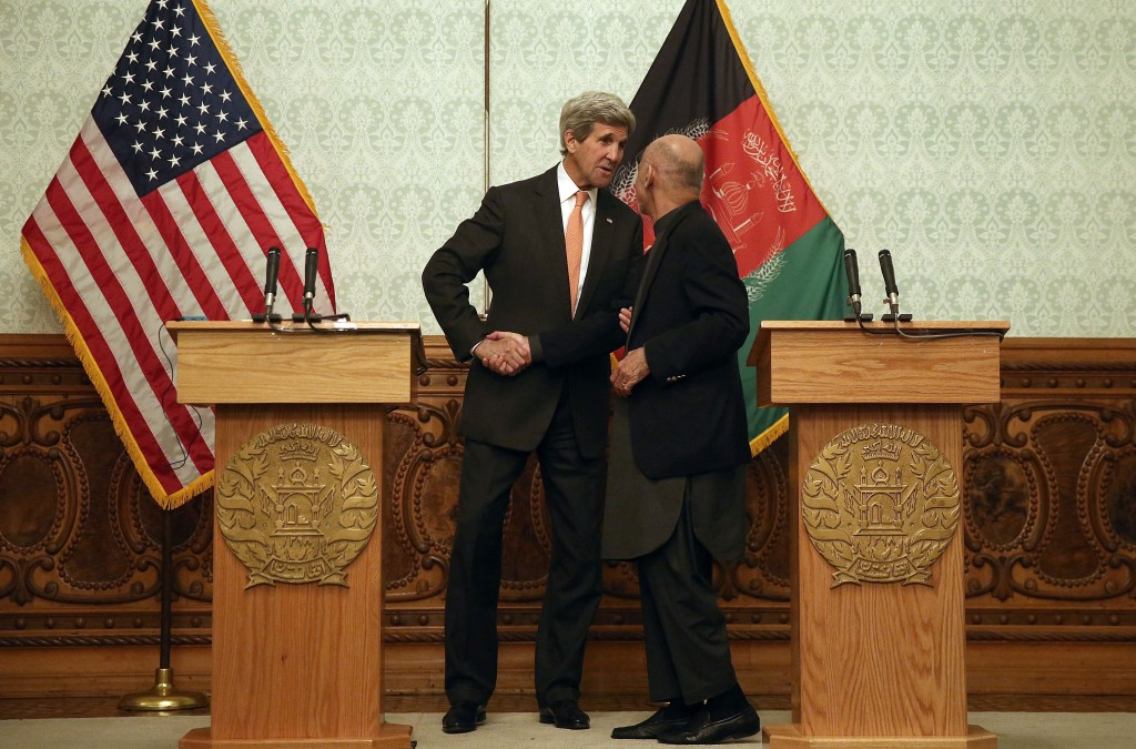 "Afghan President Ashraf Ghani, right, shakes hands with U.S. Secretary of State John Kerry, during a press conference at the presidential palace in Kabul, Afghanistan, Saturday, April 9, 2016. Kerry hoped a brief stop Saturday in Afghanistan would help promote cooperation from a would-be ""unity"" government that has proved largely incapable of running the country less than two years after he worked to install the leadership team. (AP Photo/Massoud Hossaini)"