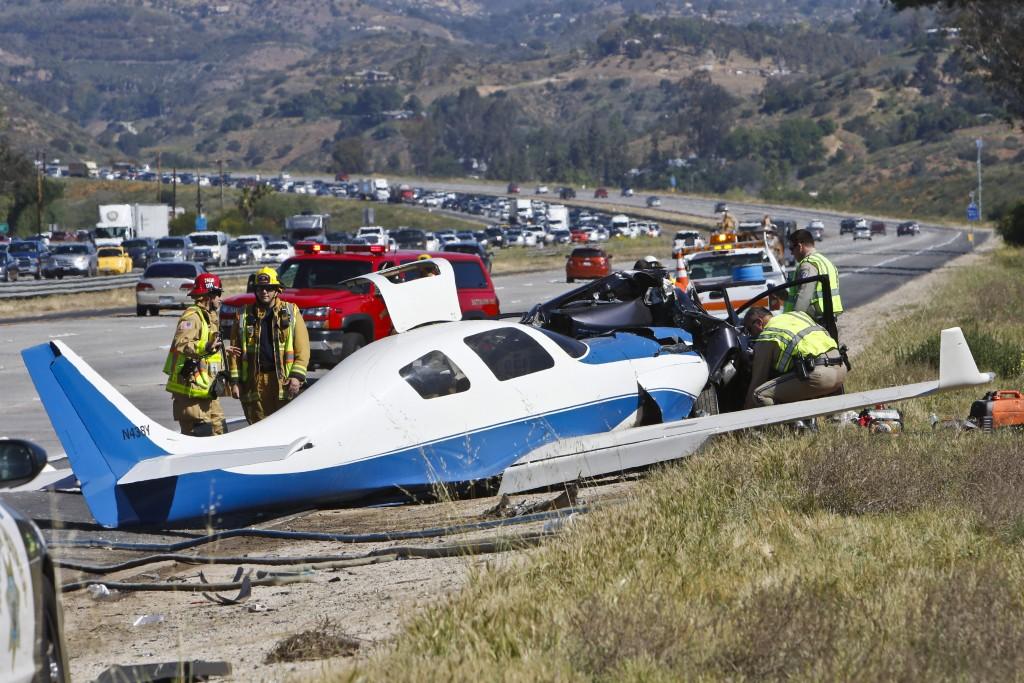 Emergency personnel investigate the scene of plane crash, Saturday. (Don Boomer/The San Diego Union-Tribune via AP)