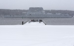 The USS Zumwalt makes it way down the Kennebec River as it heads out to sea in Bath, Maine. (AP Photo/Robert F. Bukaty)