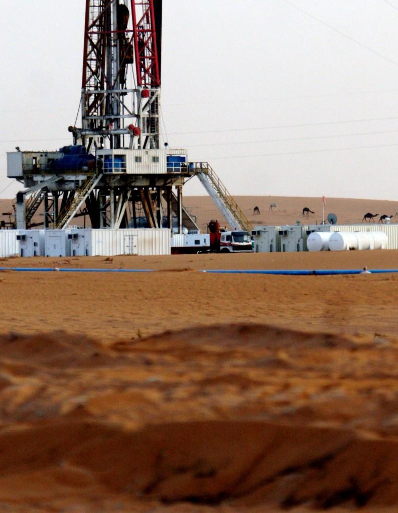 An oil well near the Khurais oil facility, about 60 miles southeast of Riyadh, Saudi Arabia. (AP Photo/Hasan Jamali)