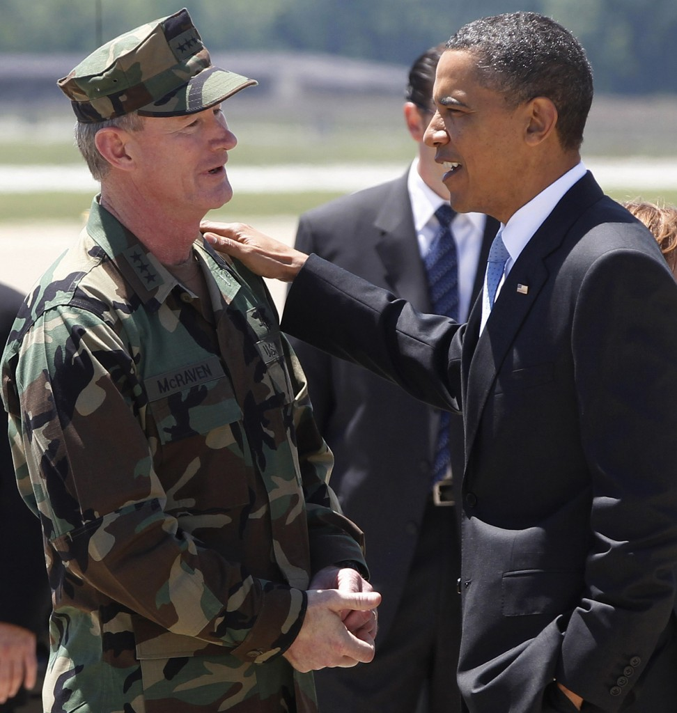 In this May 6, 2011 photo, President Barack Obama speaks with Navy Vice Admiral William H. McRaven, commander of Joint Special Operations Command, at Campbell Army Airfield in Fort Campbell, Ky., just days after McRaven led operational control of Navy SEAL Team Six's successfully mission to kill Osama bin Laden, (AP Photo/Charles Dharapak, File)