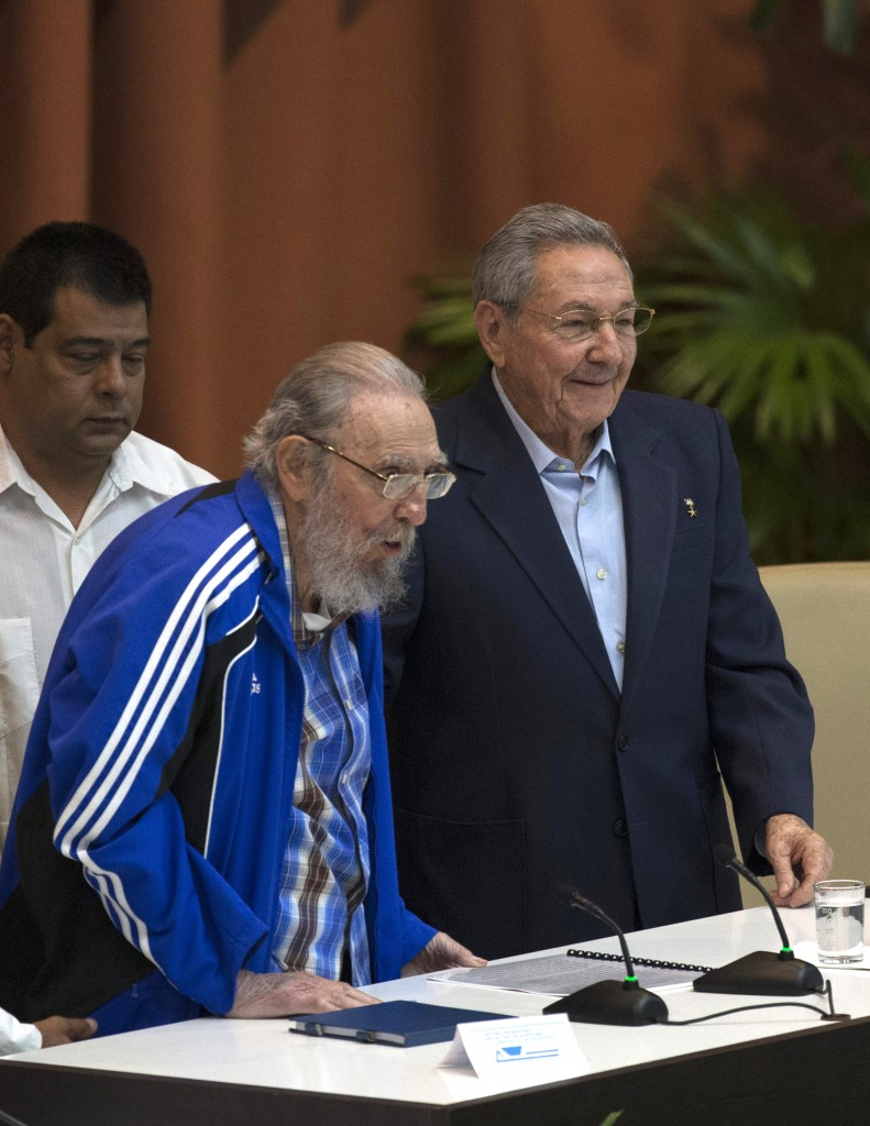 Fidel Castro, left and his brother, Cuba's President Raul Castro, attend the closing ceremonies of the 7th Congress of the Cuban Communist Party, in Havana on Tuesday. (Ismael Francisco/Cubadebate via AP)