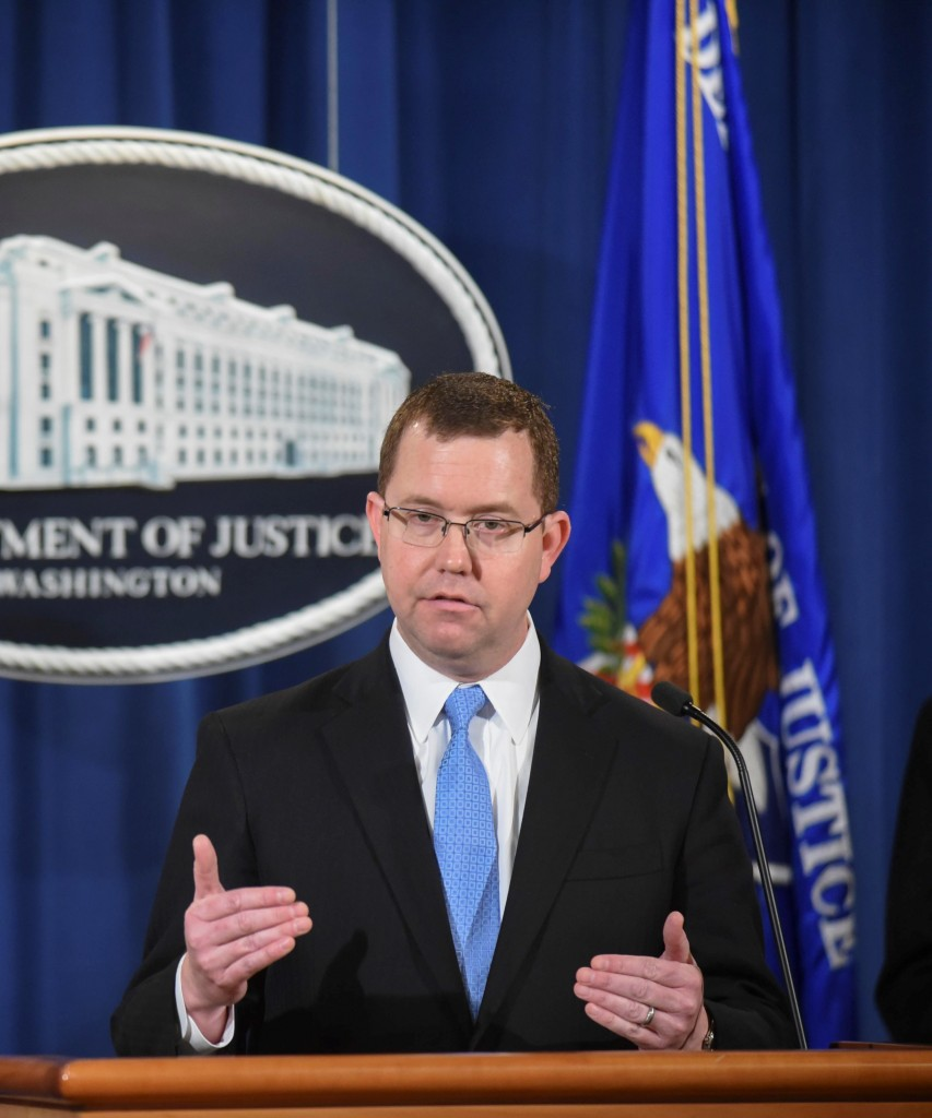 In this Feb. 3, 2015 photo, Acting Assistant Attorney General Stuart Delery speaks at a news conference regarding Standard & Poor's $1.38 billion settlementover government allegations that it knowingly inflated its ratings of risky mortgage investments that helped trigger the financial crisis. (AP Photo/Kevin Wolf)