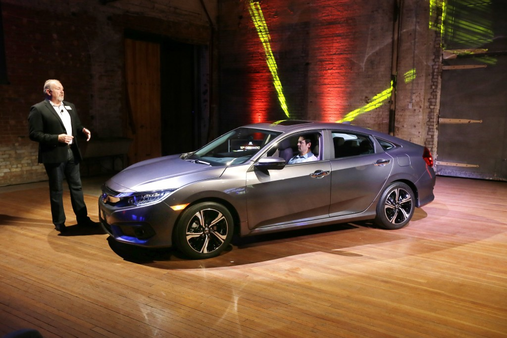 The 2016 Honda Civic, seen here at its unveiling in Detroit on Sept. 16, 2015, by American Honda Motor Co., Executive Vice President John Mendel. (AP Photo/Carlos Osorio, File)