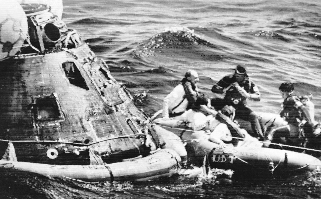 Apollo 16 astronauts in rubber raft after leaving spaceship, left, in the Pacific Ocean, April 27, 1972.  (AP Photo)