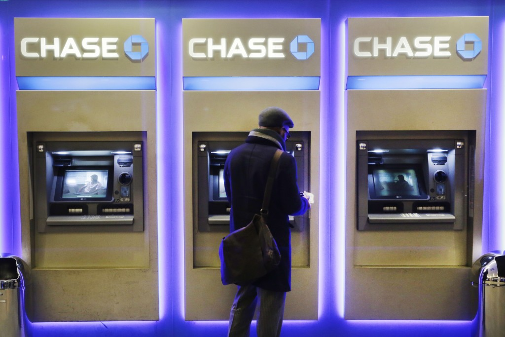A customer using an ATM at a Chase branch in New York. (AP Photo/Mark Lennihan, File)