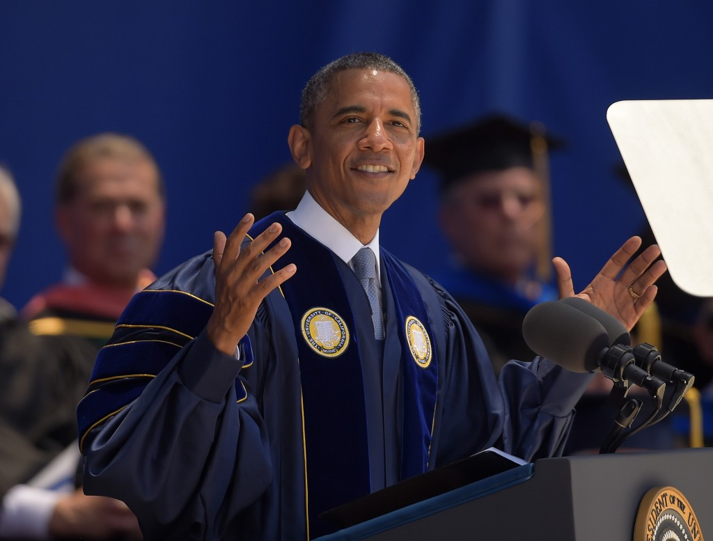 In this June 14, 2014 photo, President Barack Obama delivers the commencement address for the University of California, Irvine. (AP Photo/Mark J. Terrill)