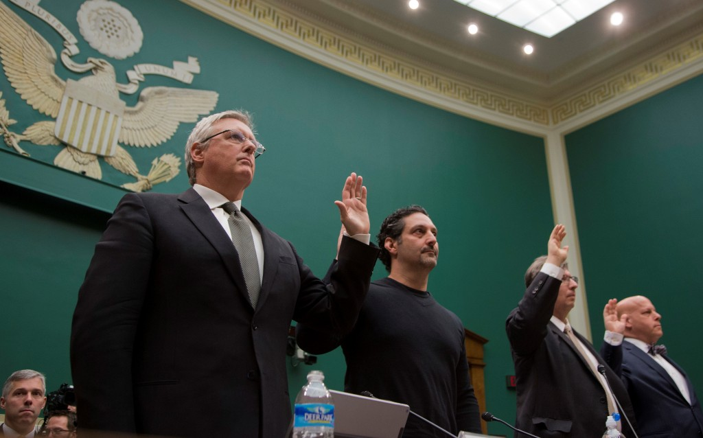 From left: Bruce Sewell, Apple Inc. General Counsel ; Amit Yoran, RSA Security President ; Matthew Blaze, associate professor of Computer and Information Science at University of Pennsylvania School of Engineering and Applied Science; and Daniel Weitzner, Director of MIT Computer Science and Artificial Intelligence Lab, and Principal Research Scientist at MIT Internet Policy Research Initiative, are sworn on Capitol Hill on Tuesday, during a House Oversight and Investigations subcommittee hearing on encryption. (AP Photo/Manuel Balce Ceneta)