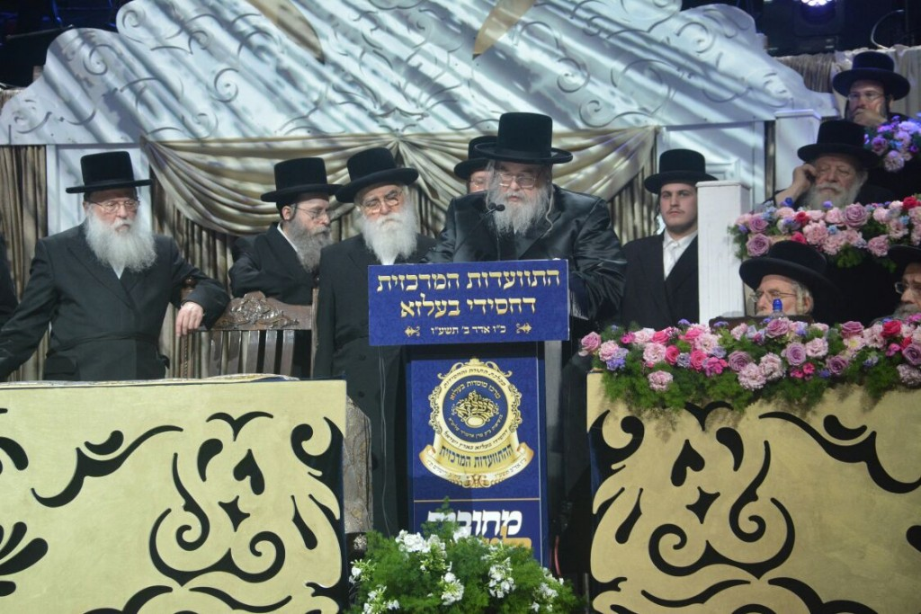 The Belzer Rebbe shlita addresses thousands of Belzer chassidim who gathered to mark 50 years of the Rebbe's leadership at the Arena hall in Yerushalayim (Eli Segal)
