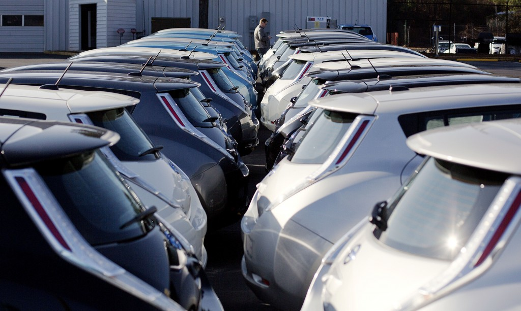 Nissan electric vehicles sit on display at an auto dealership in Roswell, Ga. (AP Photo/David Goldman, File)
