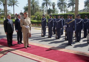 Visiting U.S. Defense Secretary Ash, second from left, and his Iraqi counterpart Khaled al-Obeidi review an honor guard during a welcome ceremony at the Ministry of Defense in Baghdad on Monday. (AP Photo)