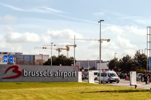 Police guard the entrance road at Brussels Airport, in Zaventem, Belgium, Sunday, April 3, 2016. Under extra security, three Brussels Airlines flights, the first for Faro in Portugal, are scheduled to leave Sunday from an airport that used to handle about 600 flights a day. (AP Photo/Geert Vanden Wijngaert)