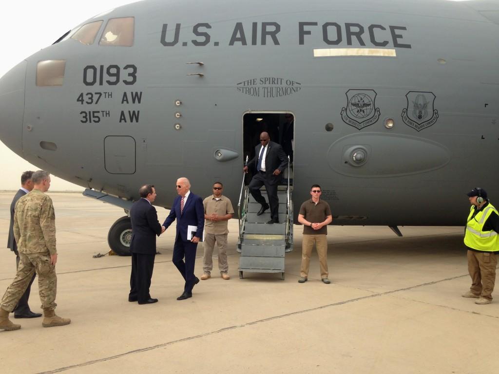 Vice President Joe Biden is greeted by U.S. Ambassador Stuart Jones after stepping off a C-17 military transport plane upon his arrival in Baghdad on Thursday. (AP Photo/Josh Lederman)