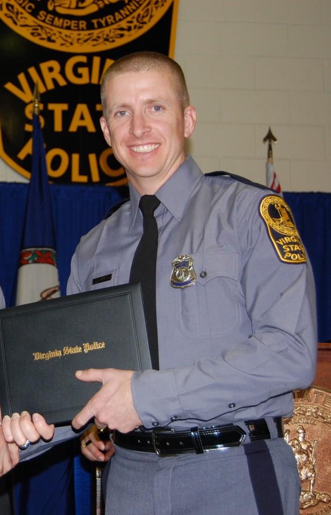 Trooper Chad P. Dermyer receives his graduation diploma in Nov. 2014. (Virginia State Police via AP)