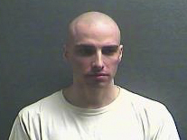 This undated photo provided by the Boone County Jail shows Christopher Lee Cornell. Cornell, a suburban Cincinnati man, the beard and long hair he had when arrested gone, has been calling himself again by his birth name and appears competent to stand trial on charges that he plotted to attack the U.S. Capitol in support of the Islamic State group, according to testimony Monday, April 18, 2016. (Boone County Jail via AP)