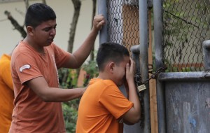 Boys cry after they find out their sister has been killed in an earthquake in Pedernales, Ecuador. (AP Photo/Dolores Ochoa)
