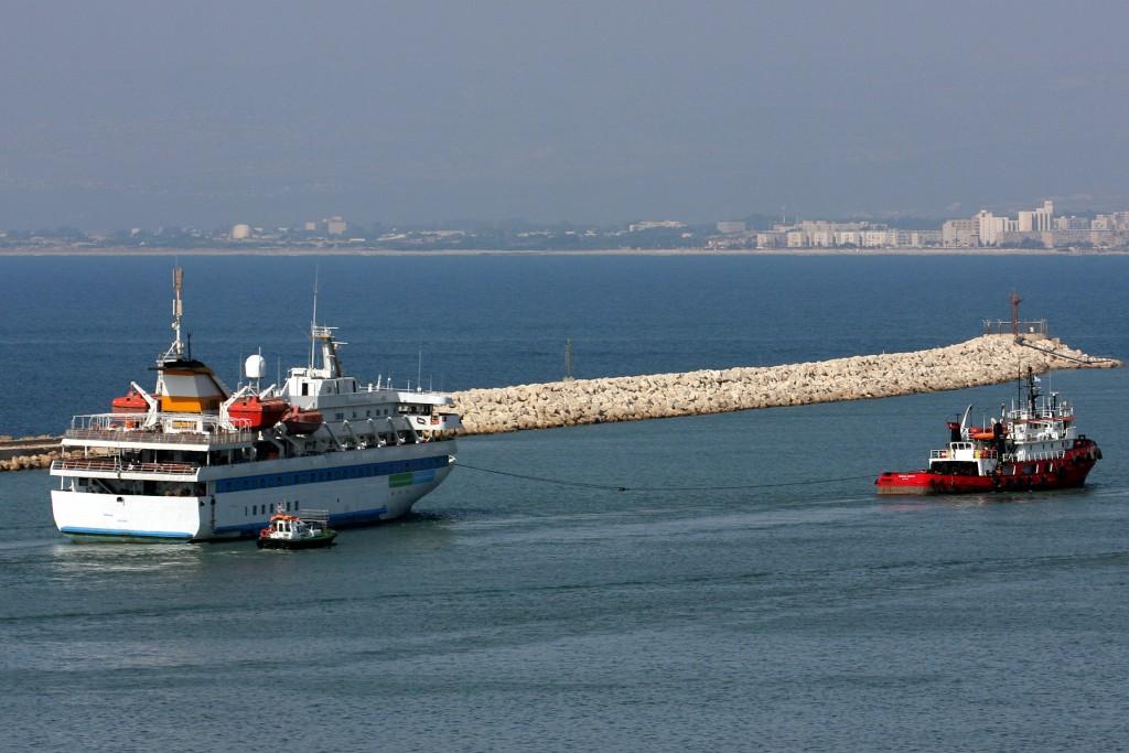 The cruise liner Mavi Marmara is towed by a Turkish tugboat (R) as it leaves the port of the northern city of Haifa August 5, 2010. Israel released an impounded Turkish aid ship on Thursday on which its navy killed nine pro-Palestinian activists in a botched boarding as they tried to run the Gaza Strip blockade in May Photo by Herzl Shapira/Flash 90*** Maariv & Agencies OUT *** *** Local Caption *** ùçøåø îøîøä ðîì çéôä äîùè ìòæä îùè òæä ñôéðä