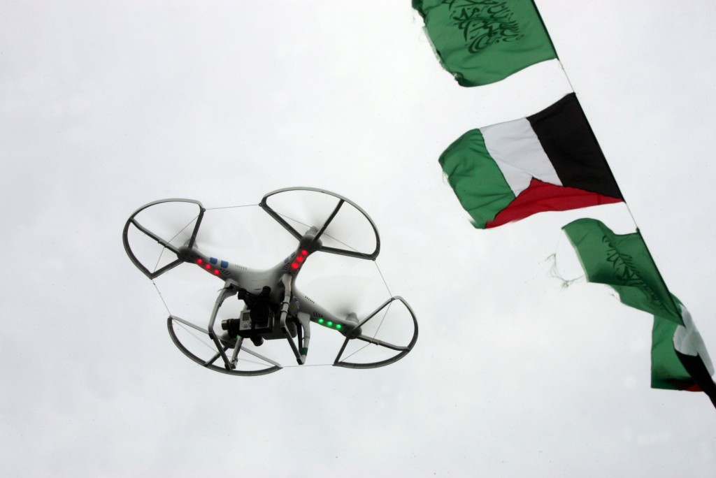 A flying drone camera was used by the Islamic Resistance Movement Hamas in Gaza City during a rally of tens of thousands of Hamas supporters to commemorate the 10-year anniversary of the assassination of the group's spiritual leader Sheik Ahmed Yassin in an Israeli airstrike a decade ago, in Gaza City on March 23, 2014. Photo by Abed Rahim Khatib / Flash90 *** Local Caption *** . îöìîä ãâì ôìñèéðé ãâì ôìùúéðé