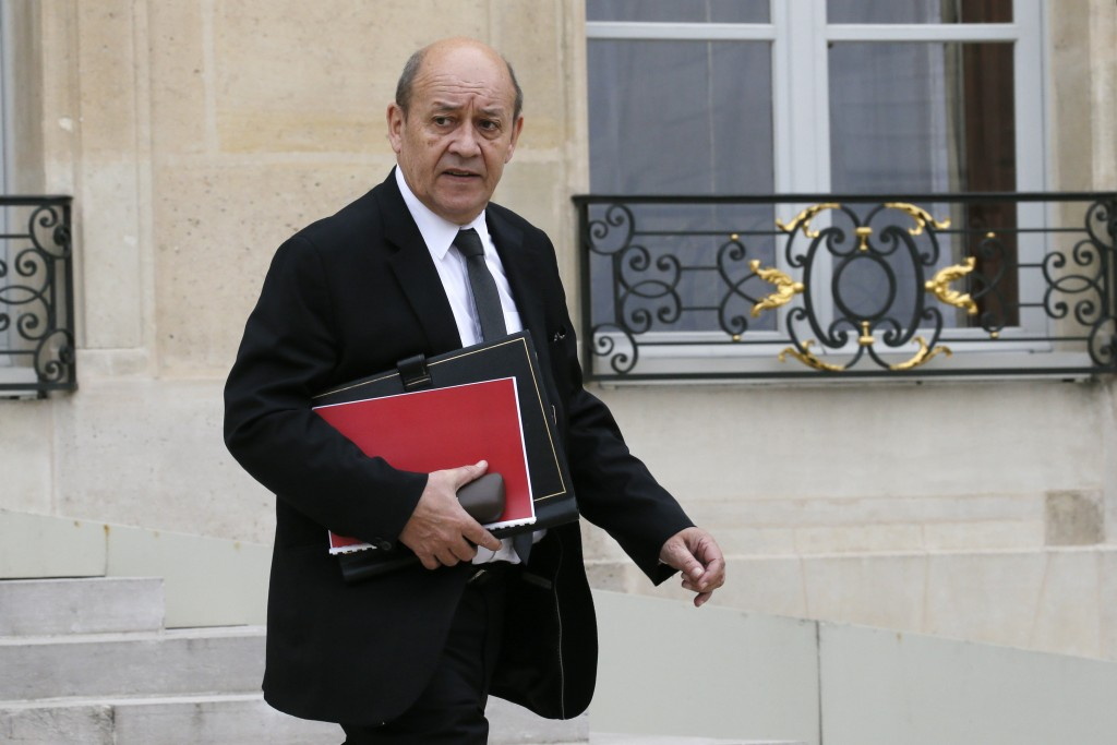 French Defence Minister Jean-Yves Le Drian leaves the Elysee Palace following the weekly cabinet meeting in Paris, France, March 24, 2016. REUTERS/Gonzalo Fuentes